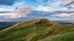 Sunset Clouds over Mam Tor Hill in Peak District, UK Stock Footage