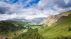 Fast Moving Dramatic Cumulus Clouds over Keswick Valley in Lake District, UK Stock Footage