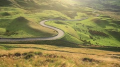 Curvy Countryside Road at Sunset in Peak District UK Stock Footage