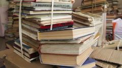 Stack of Books Scattered on the Floor in the Library Stock Footage