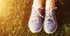 Female feet in sneakers gumshoes, close up. Slow motion, 120fps. Stock Footage