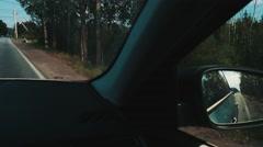 Car passes young boy hitchhiking at road. Traveler. Thumb up. Summer day Stock Footage