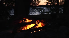 Camp fire by the lake at sunset - Slow Motion Stock Footage