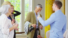 4K 3 generations of a family socializing and drinking champagne in elegant home Stock Footage
