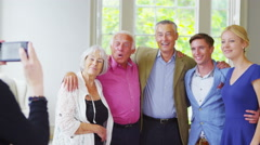 4K Three generations of a happy family pose together for a photograph at home. Stock Footage