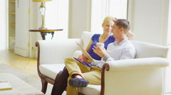 4K Attractive young couple relaxing together in elegant home Stock Footage