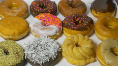 Donuts Dozen Taken One By One.  4k Stock Footage