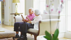 4K Happy senior couple at home get a surprise visit from their family Stock Footage