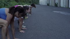Outdoor group exercise class Stock Footage