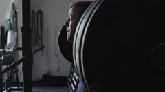 Very cinematic intense athlete squatting Stock Footage