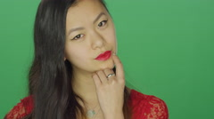 Young Asian woman staring and being flirty, on a green screen background Stock Footage