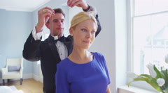4K Attractive young couple in formal evening wear preparing for an evening out. Stock Footage