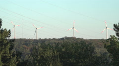 A four windmills spinning off and producing green eco energy. Stock Footage