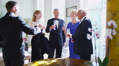 4K Generations of a family in evening wear raise champagne glasses for a toast Stock Footage