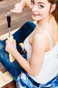 Woman assembling wooden furniture. DIY. Stock Photos