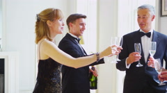 4K Generations of a family in evening wear drinking champagne and going out Stock Footage