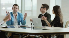 Colleagues applauding the boss Stock Footage