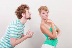 Man asking for forgivness. Conflicted couple. Stock Photos