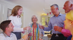 4K Three generations of a happy family raise champagne glasses for a toast Stock Footage