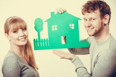 Young couple with ecological green house. Stock Photos