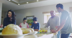4K 3 Generations of a happy family preparing a meal together in kitchen at home Stock Footage