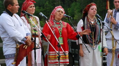 Group of people in the ethnic national costumes singing outdoor (Editorial) Stock Footage
