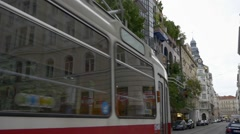 Tram is passing Hundertwasser house Stock Footage