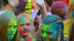 Crowd of young people dancing at the holi color powder festival (Editorial) Stock Footage