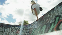 Ramped slow motion skate board back flip in bowl Stock Footage