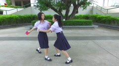 Cute Asian high schoolgirls student couple playing with friend action Stock Footage