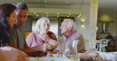 4K Large happy family group eating a meal together at home Stock Footage