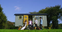 4K 3 Generations of a happy family relaxing outside gypsy caravan Stock Footage