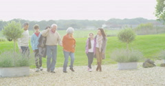 4K Family group of different generations take a walk outdoors on autumn day Stock Footage