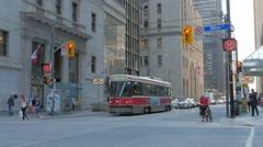 Streecars Passing Toronto TTC Public Transit Traffic Intersection Yonge Street Stock Footage