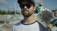 Man and skateboard close up Stock Footage