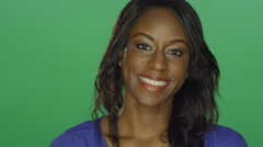 Beautiful African American woman smiling, on a green screen background Stock Footage