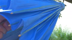 Opening up a parasol umbrella Stock Footage