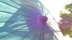 Parasol umbrella up close light  Stock Footage