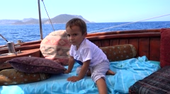 Restless kid suffering with nausea aboard Stock Footage