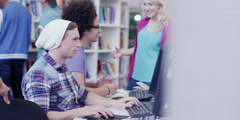 Diverse group of students working together in study area of modern university Stock Footage