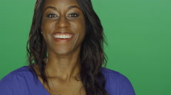 African American woman making silly faces, on a green screen background Stock Footage