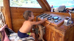 Small captain at the wheel Stock Footage