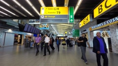 Schiphol airport, departures terminal main hall with travelers passing by. Stock Footage