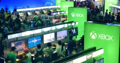 People gaming in Microsoft XBOX booth at E3 2016 expo. Timelapse. Stock Footage