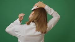 Woman brushing hair Stock Footage