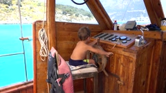 Small master steers the boat Stock Footage