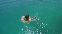 Top view child floats in an air ring Stock Footage