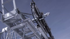 Ski resort. Construction of ski lifts. Height. Sunny day in snowy mountains Stock Footage