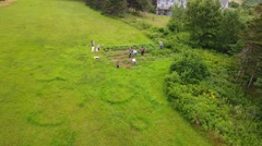 Aerial shot of a family weeding the vegetable garden Stock Footage