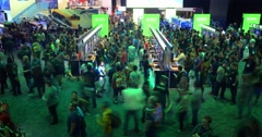 Crowds of gamers playing games in Microsoft XBOX booth at E3 2016 expo Stock Footage